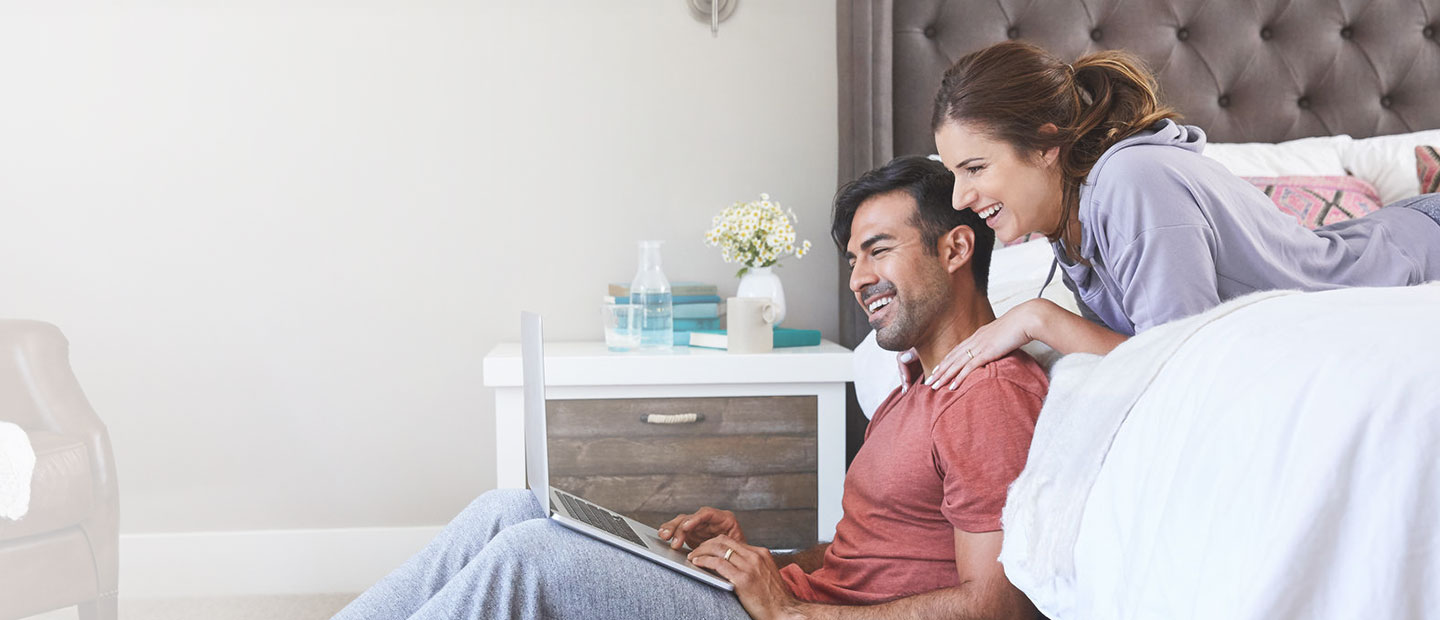 man and woman taking a customer survey at home